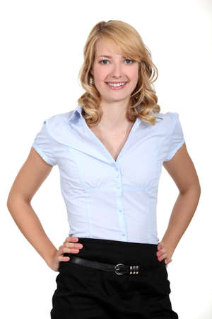 tight fitting: Portrait of a woman standing with her hands on her hips Stock Photo