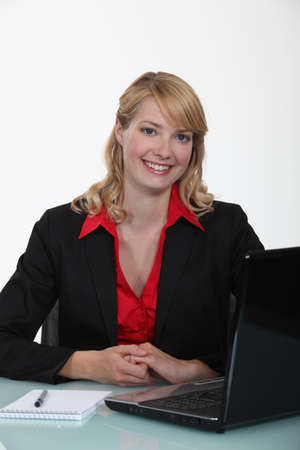 Businesswoman sitting at a laptop photo