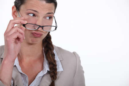 business skeptical: businesswoman looking critical Stock Photo