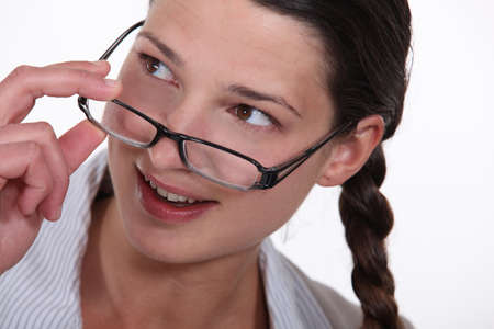 woman putting on her glasses photo