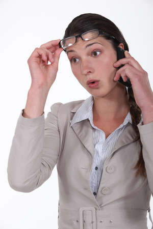 woman surprised on the phone Stock Photo - 16808425