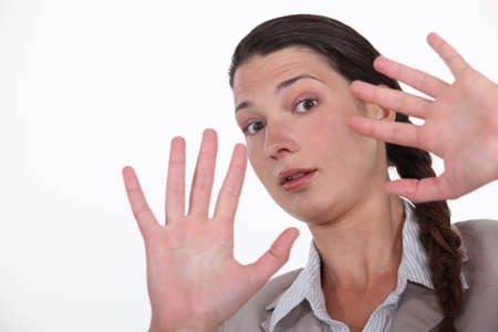 Shocked woman holding hands up Stock Photo - 16808001