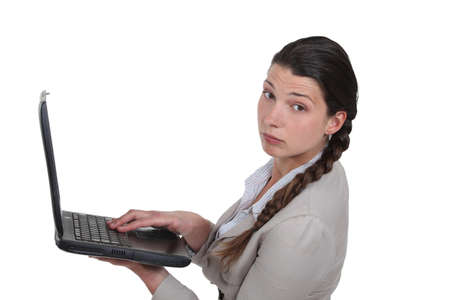 jaded: Jaded woman holding a laptop Stock Photo