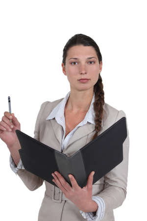 Secretary holding office supplies Stock Photo - 16807973