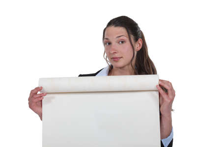 uncovering: Woman unrolling a roll of paper