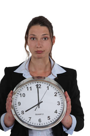 Businesswoman with a clock showing 8am Stock Photo - 16807546