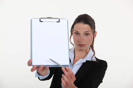 A businesswoman presenting a contract Stock Photo - 16807599