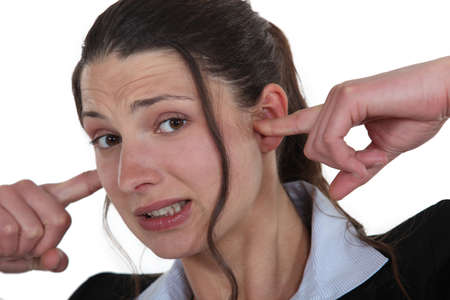 Businesswoman with her fingers in her ears Stock Photo - 16808166