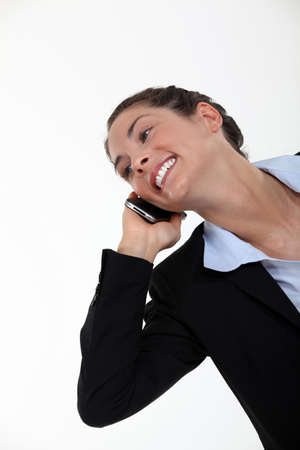 A happy businesswoman over the phone  Stock Photo - 16807970