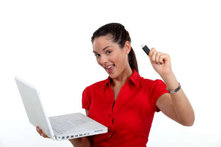 usb2: Woman holding laptop and USB key