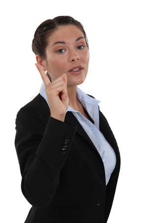 Businesswoman pointing her finger photo