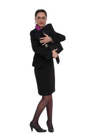 possessive: Businesswoman protecting her briefcase Stock Photo