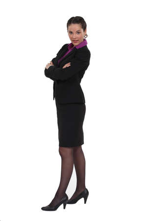 Businesswoman in a skirt suit Stock Photo - 16804360