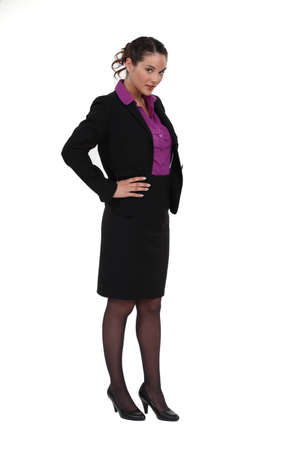 arms akimbo: portrait of cute businesswoman