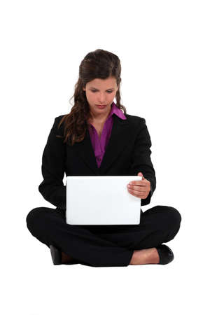 Businesswoman sat barefoot with laptop Stock Photo - 16805242