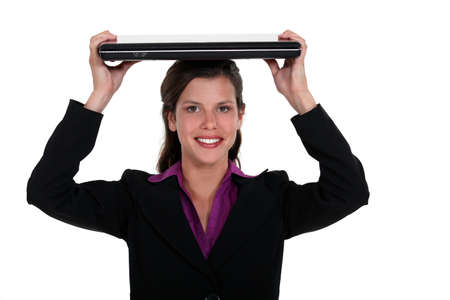 Woman holding a laptop on her head Stock Photo - 16805777