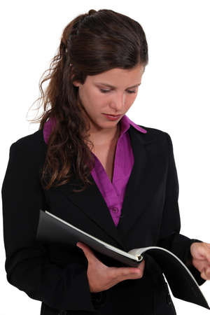 Brunette reading contents of folder photo
