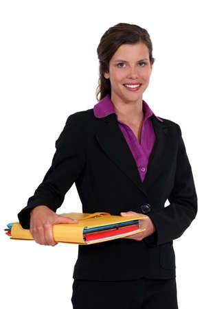 Businesswoman holding files Stock Photo - 16806001