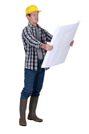 Foreman examining plans Stock Photo - 16805879