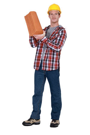 Tradesman holding terracotta shingles Stock Photo - 16807337