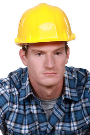 downcast: Depressed construction worker