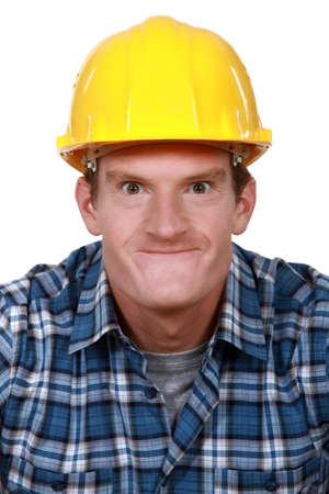 protrude: Tradesman making a silly face Stock Photo