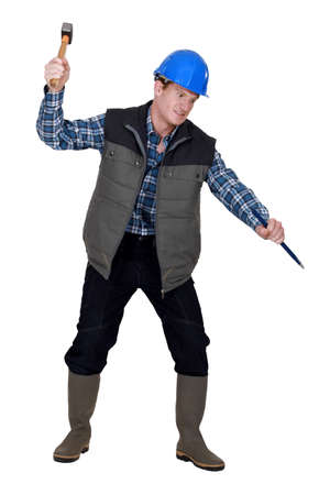 deranged: Crazy man using a hammer and chisel Stock Photo