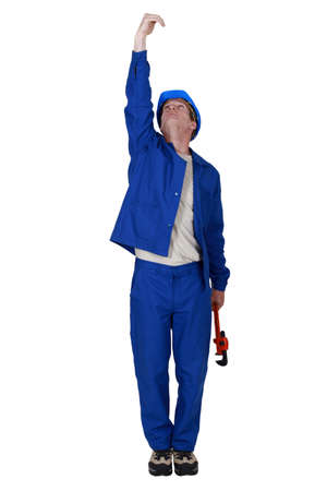 Plumber with wrench reaching upwards Stock Photo - 16804495