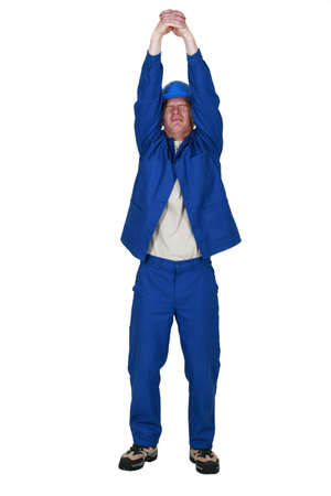 man in jumpsuit stretching his arms Stock Photo - 16804498