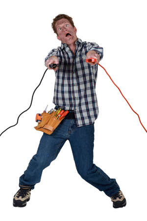 conductive: Man being electrocuted Stock Photo