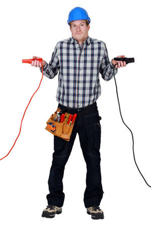 Confused electrician holding voltmeter Stock Photo - 16807221