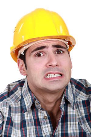 anguished: Portrait of scared laborer