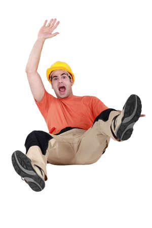 plunge: craftsman slipping and falling on the floor Stock Photo