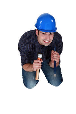 Nervous woodworker holding hammer and chisel Stock Photo - 16889998