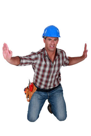 Contractor being squeezed Stock Photo - 16842046