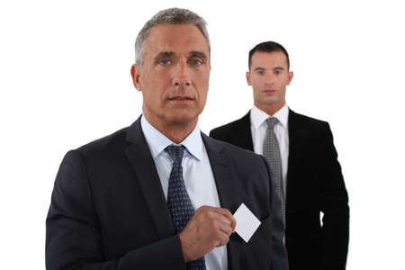 Company CEO removing business card from pocket Stock Photo - 16842009