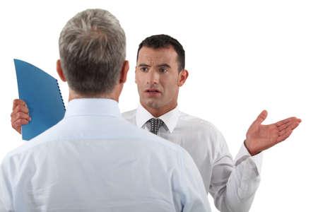 Businessman explaining himself Stock Photo - 16890206