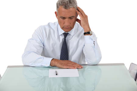 unhappy worker: Confused businessman reading document