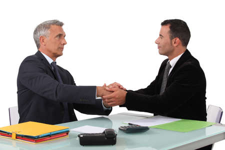 affiliation: A business handshake Stock Photo