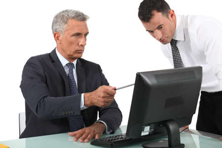 businessman giving explanations to his boss photo