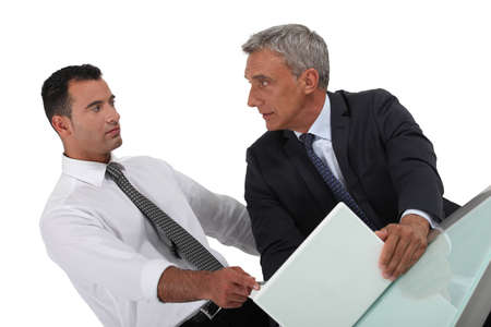 allegation: Serious businessman pointing at a colleague