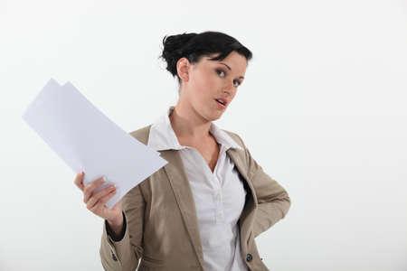 business attire teacher: Woman holding sheets of paper