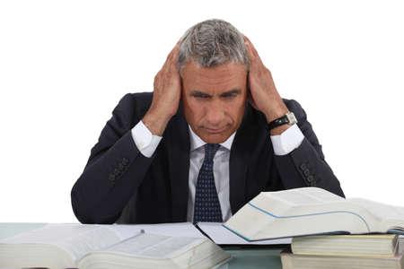 terminology: Businessman hitting the books