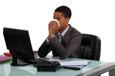 appointee: Businessman blowing his nose Stock Photo
