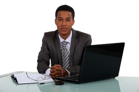 Young businessman sitting at his desk Stock Photo - 16890050