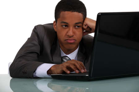 Worker falling asleep in front of computer Stock Photo - 16842089