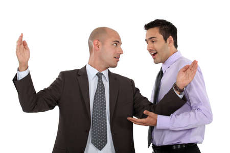 stretched: duo of businessman discussing in expressive way