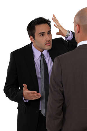 Two businessmen disagreeing photo