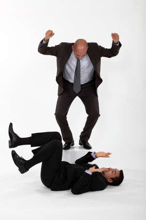 Businessmen having a fight Stock Photo - 16842108