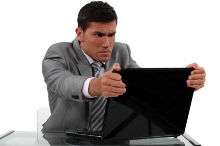 Businessman alarmed at his laptop Stock Photo - 16842079